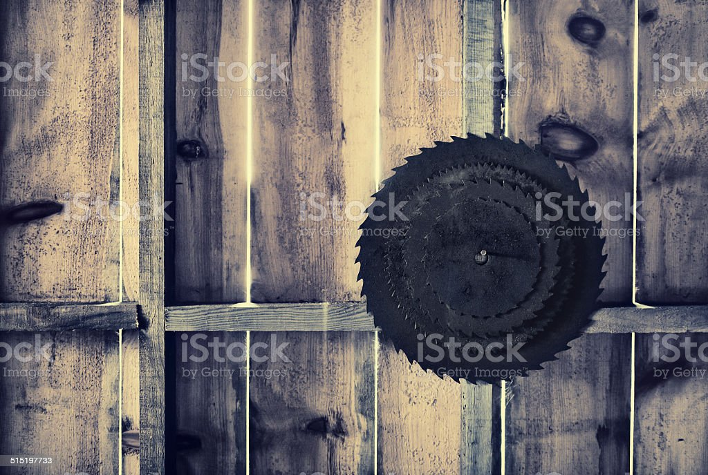 Rusted Circular Saw Blades on a Wooden Wall - Retro stock photo