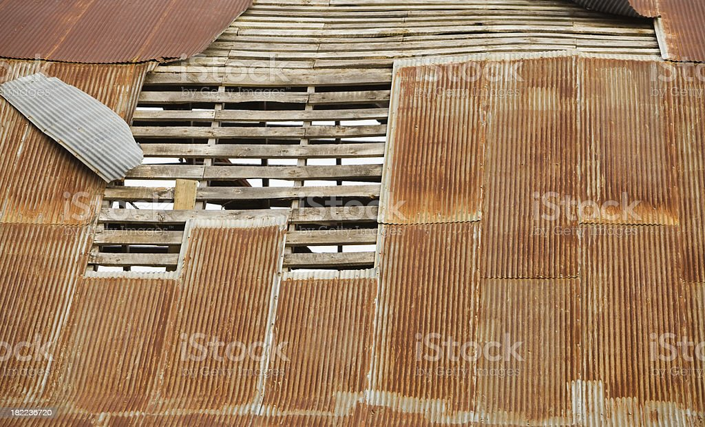 Rusted Corrugated Metal Roof Peeling from Frame royalty-free stock photo