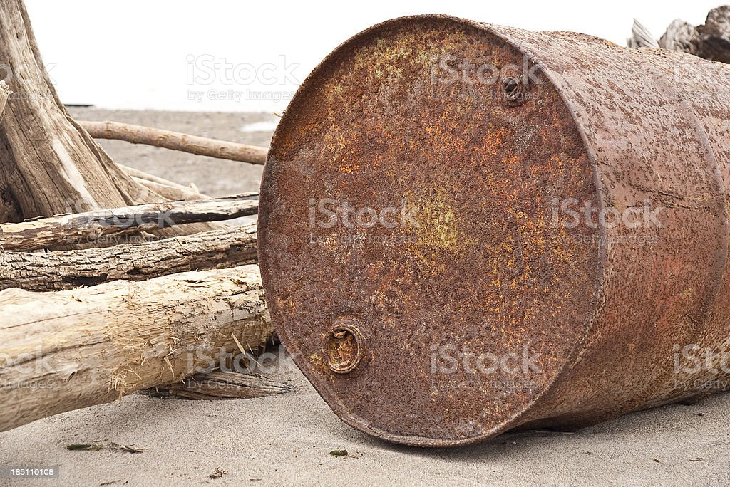 Rusted Drum on a Beach royalty-free stock photo