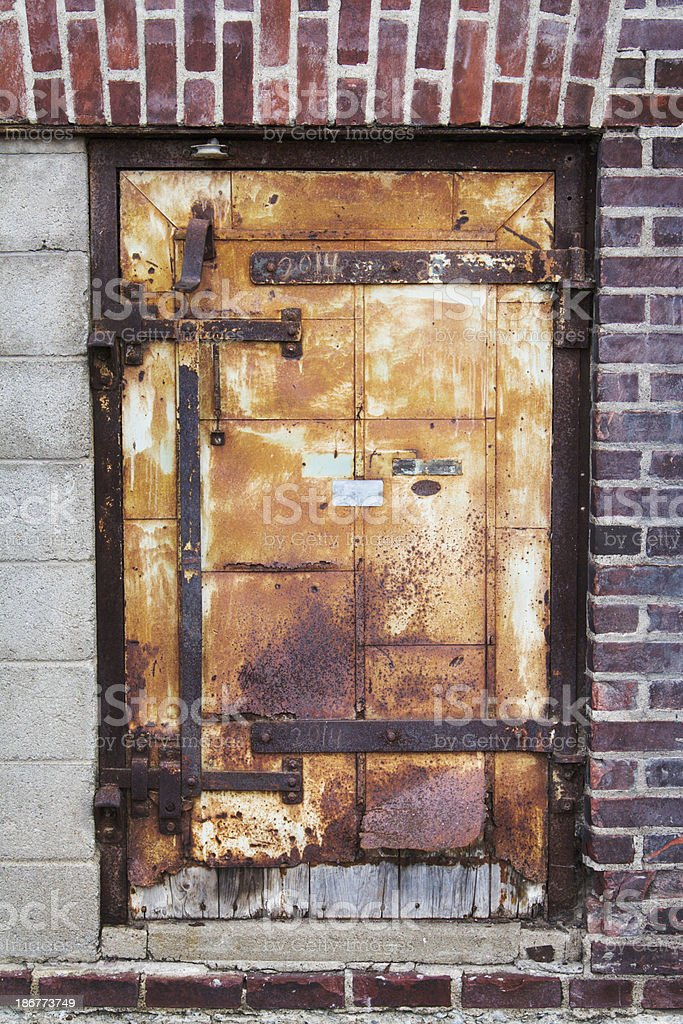 Rusted Grunge Metal and Wood Door of Old Industrial Building royalty-free stock photo