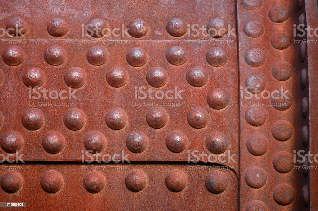 Rusted Iron Panel with Round Nubs Full Frame royalty-free stock photo