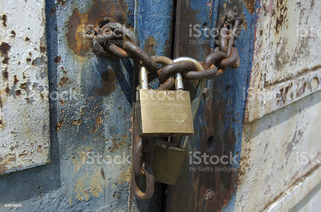 Rusted lock and chain royalty-free stock photo