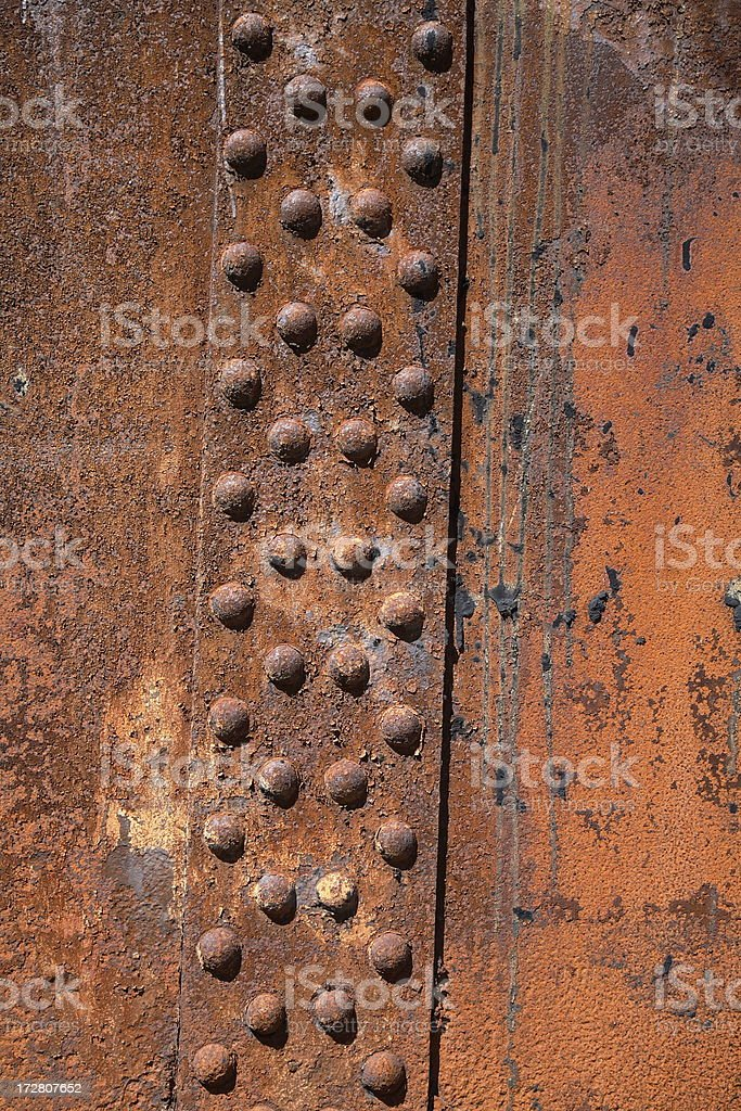 Rusted metal and rivets royalty-free stock photo