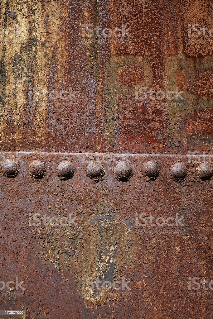 Rusted metal and studs royalty-free stock photo