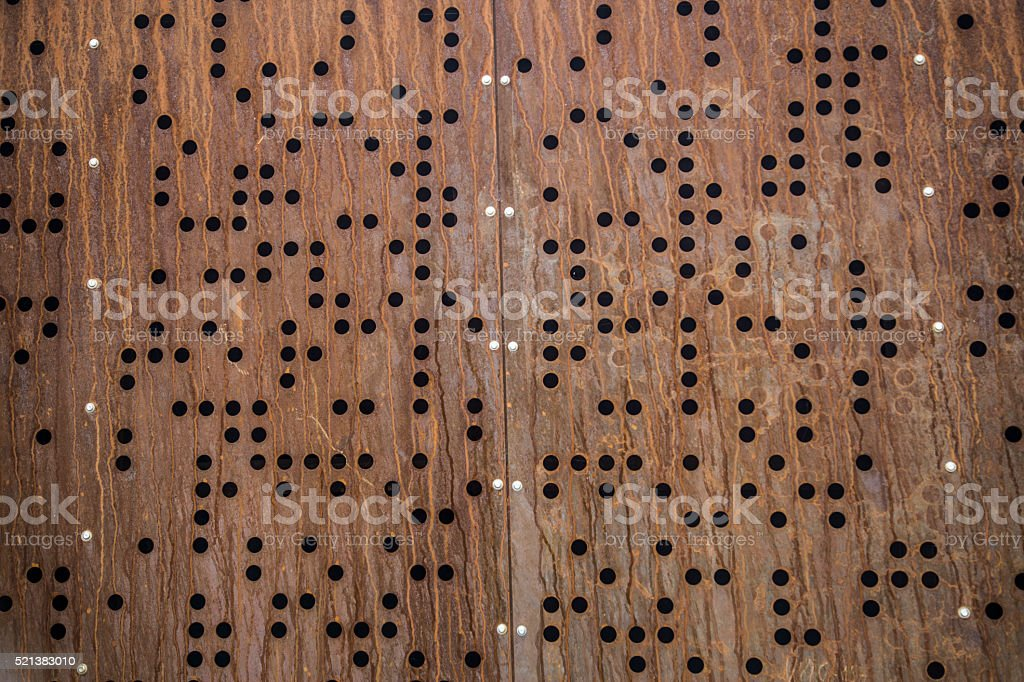 rusted metal braille holes texture steampunk stock photo