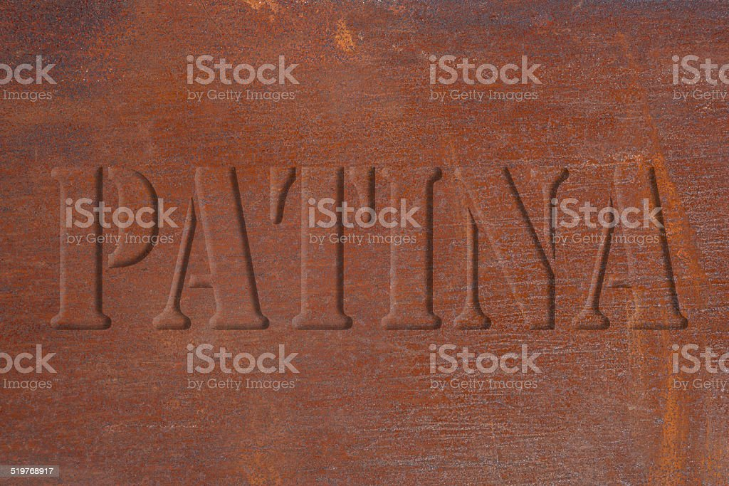Rusted metal plate with a font in relief royalty-free stock photo