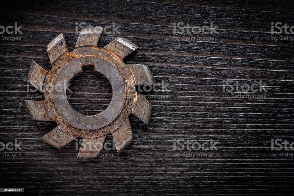 Rusted milling cutter on vintage wooden board construction conce stock photo