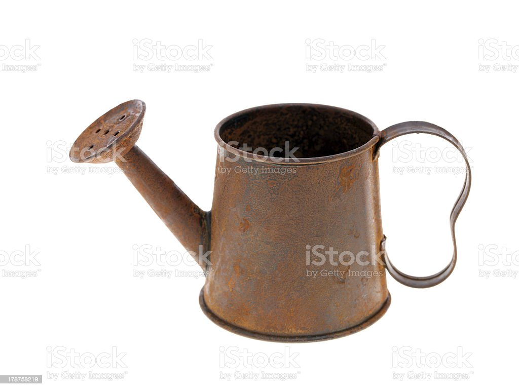 rusted miniature watering can stock photo