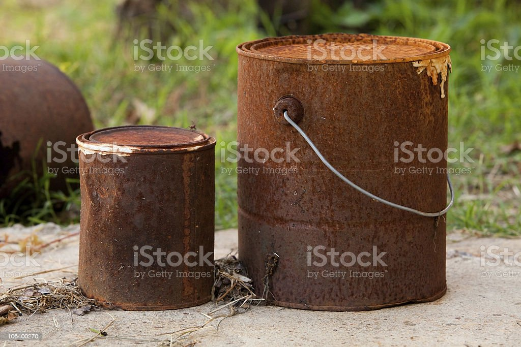 Rusted Paint Cans in Natural Setting royalty-free stock photo