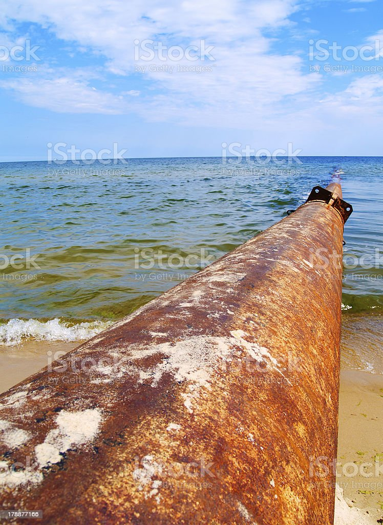 rusted pipe in sea royalty-free stock photo