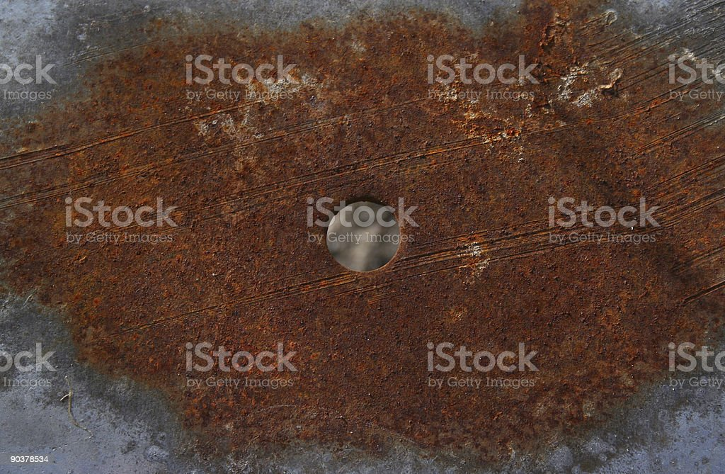 Rusted plate with a hole royalty-free stock photo