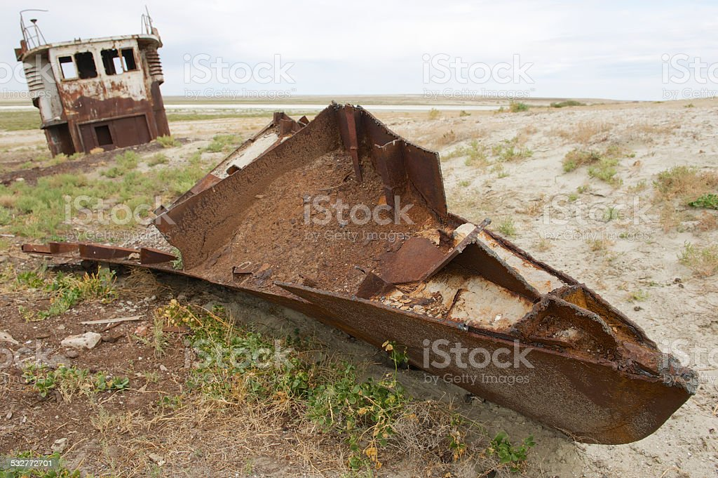 Rusted remains of fishing boat,  Aralsk, Kazakhstan. stock photo