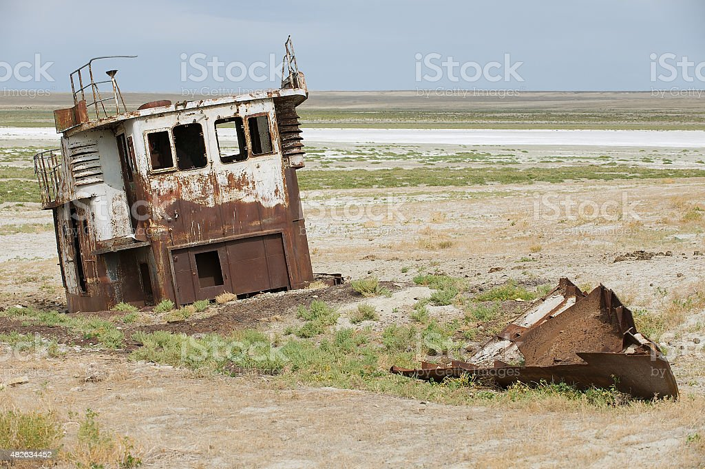 Rusted remains of the  fishing boat, Aralsk, Kazakhstan. stock photo