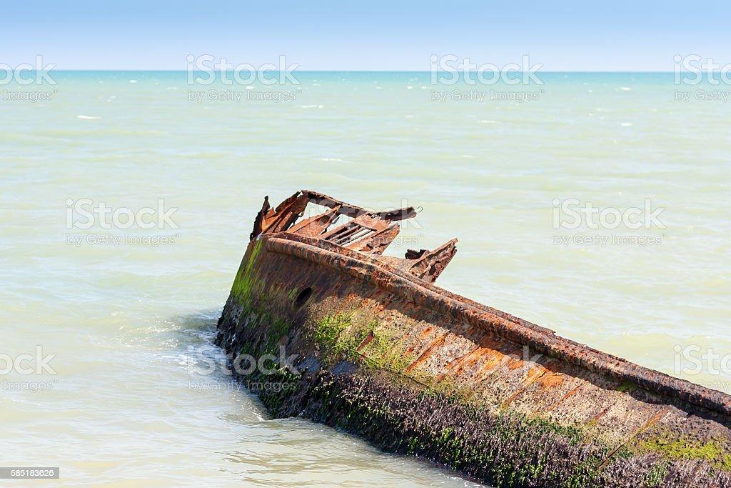 Rusted ship wreck in sea stock photo