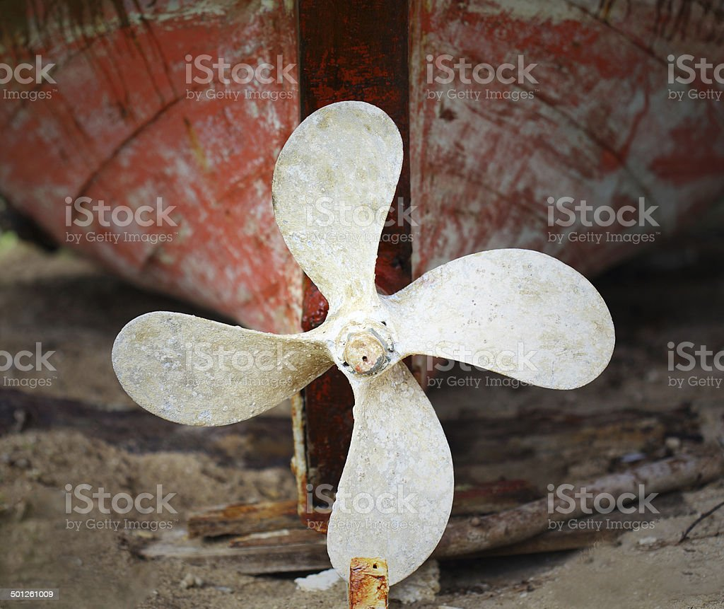 rusted ship's propeller on a old fisherman boat stock photo
