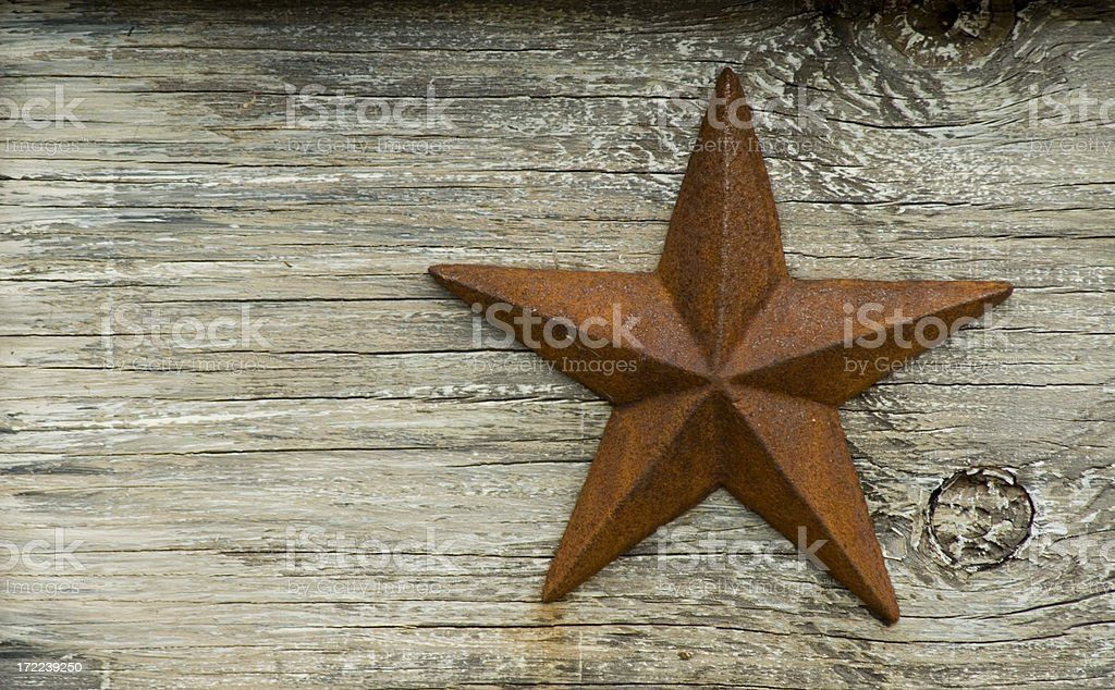 Rusted Texas star on a wooden platform stock photo