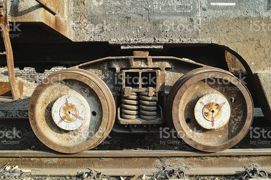 Rusted train wheel and railtrack in outside royalty-free stock photo