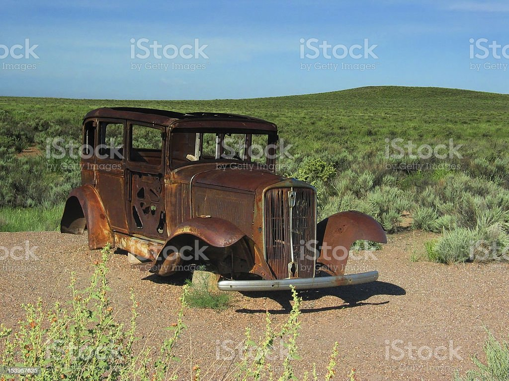 Rusted Vintage Car on Old Route 66 royalty-free stock photo