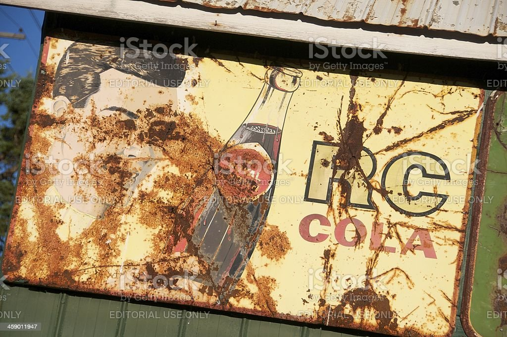 Rusted Vintage RC Cola Sign stock photo