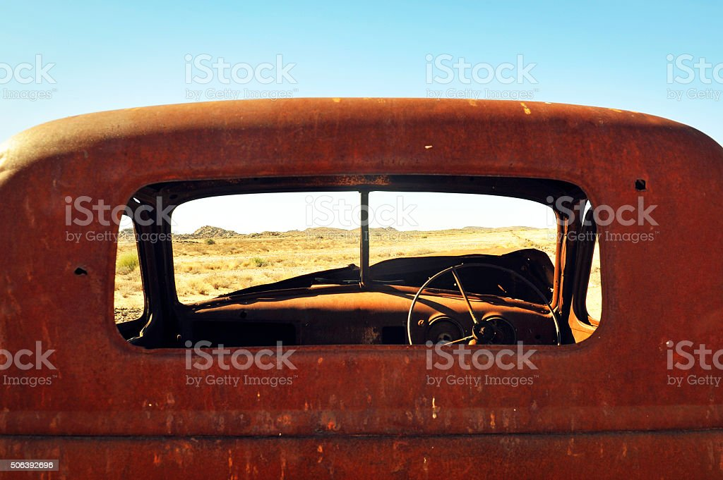 Rusted wreck in the desert stock photo