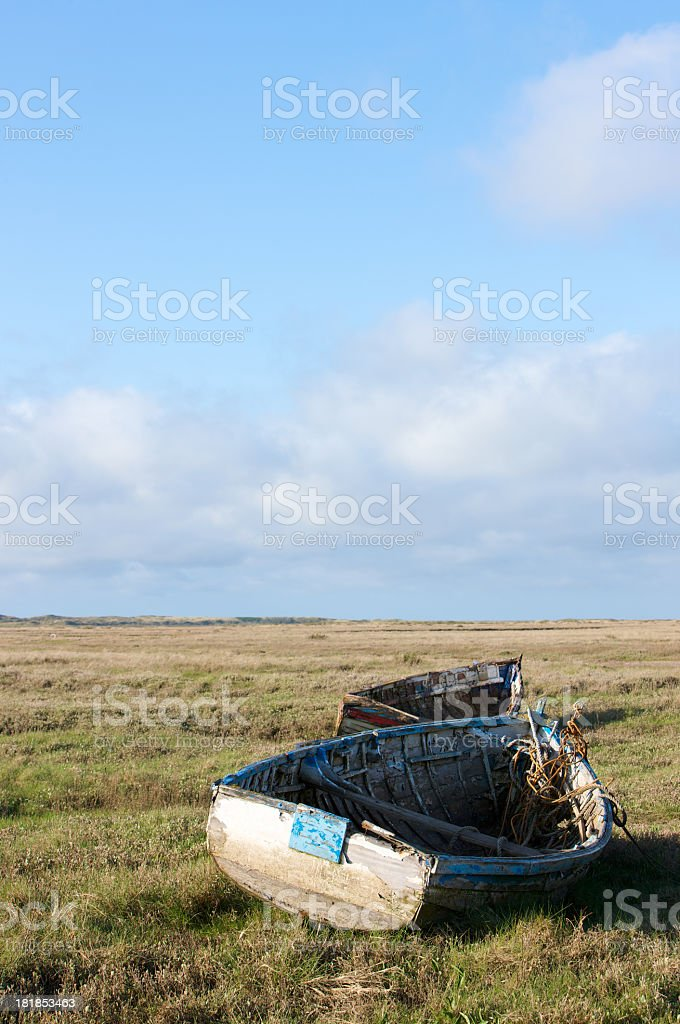 Rustic abandoned wooden rowing boats on coastal inland waters royalty-free stock photo