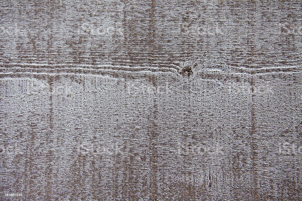 Rustic and stained plank of a wooden wall stock photo