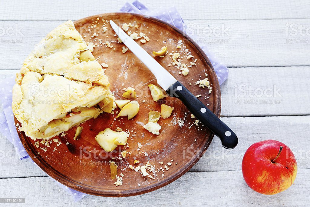 rustic apple pie on a tray, two slices stock photo