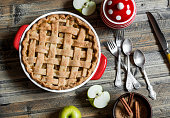 Rustic apple pie on wooden table, top view.