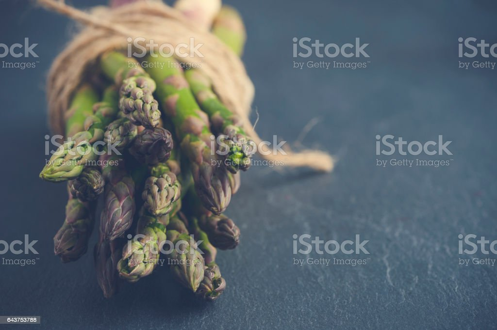 Rustic Asparagus bunch with string. stock photo