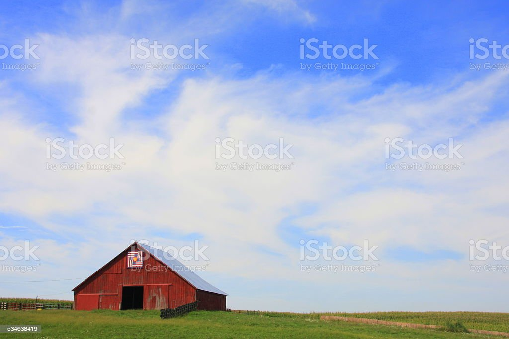Rustic Barn and Barn Quilt Under the Iowa Sky stock photo