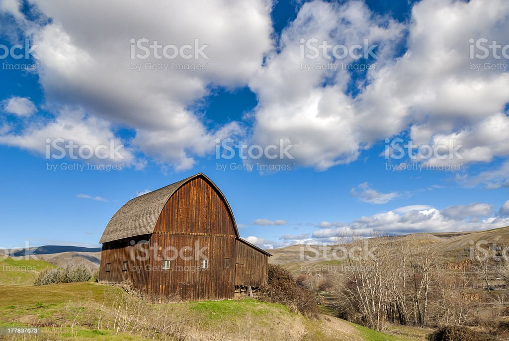 Rustic Barn and beautiful clouds Lapwai Idaho royalty-free stock photo