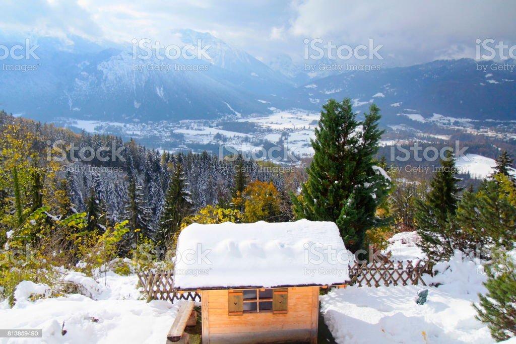 Rustic barn under snow and Waxenstein  Bavarian Alps, idyllic Pine trees woodland under snow landscape, majestic alps valley, dramatic Bavaria german Snowcapped mountain range panorama, Berchtesgaden alps, Germany stock photo