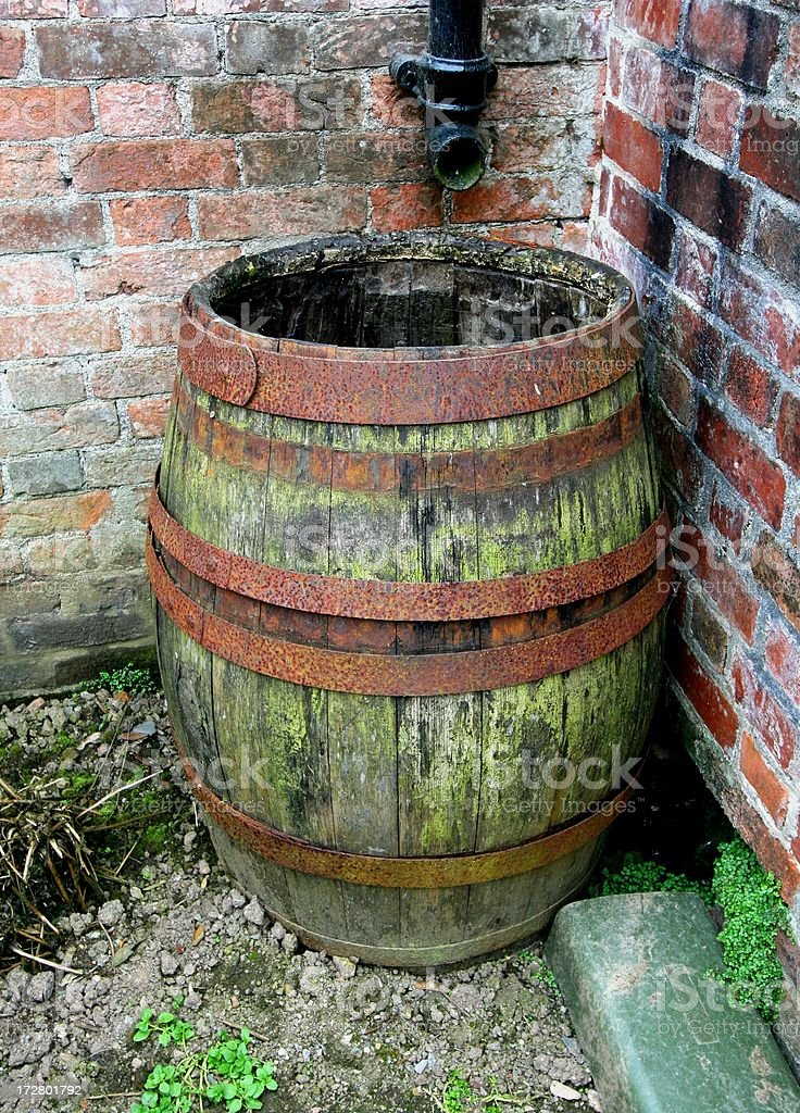 Rustic barrel collecting rainwater stock photo