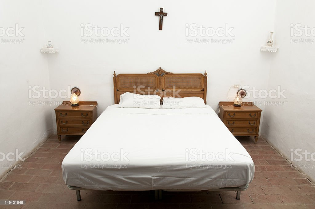 Rustic bed in a country cottage stock photo