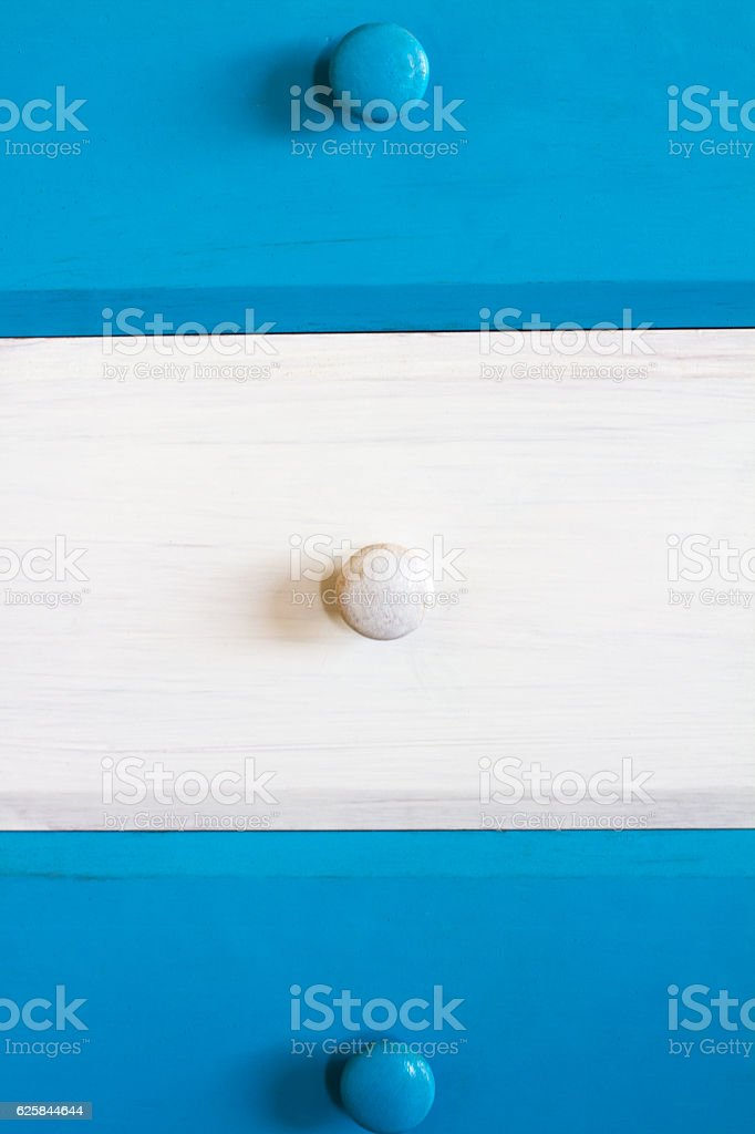 Rustic Blue and White Drawers with Knobs, Close-Up stock photo