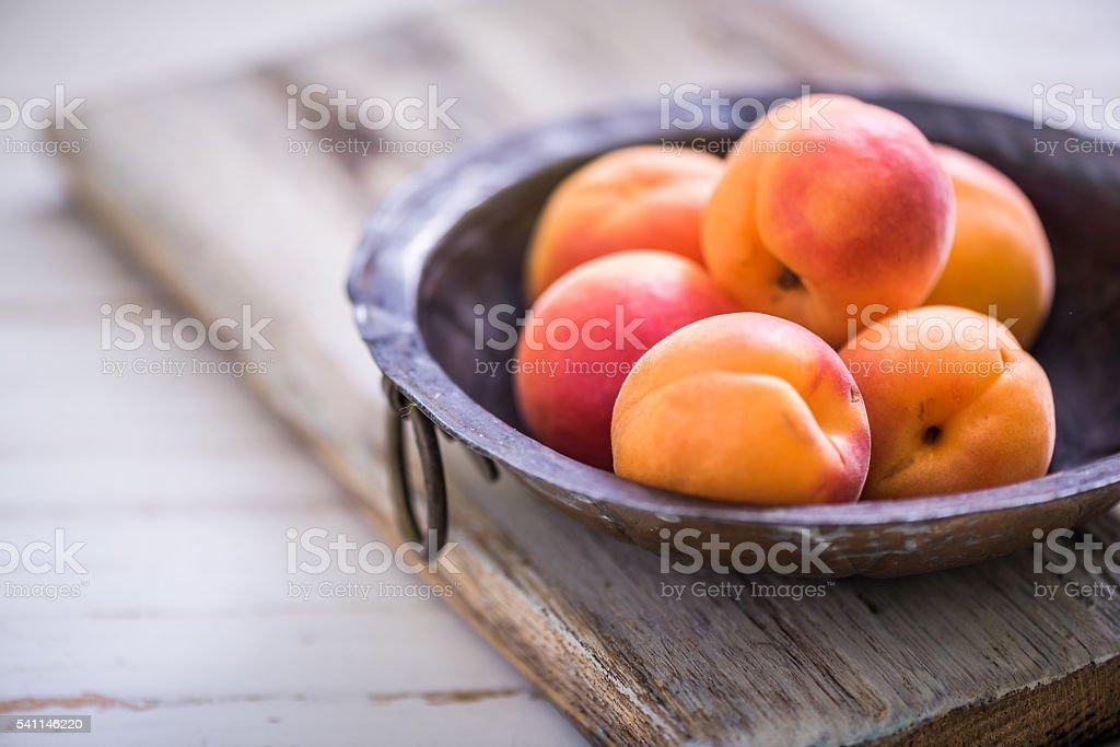 rustic bowl with fresh ripe nectarines stock photo