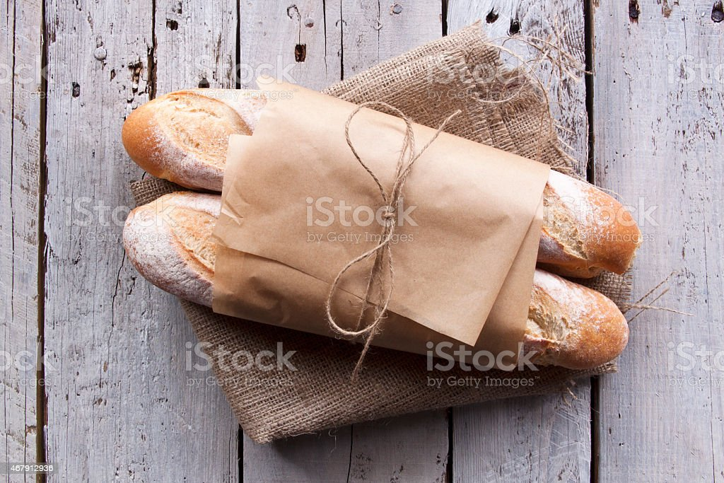 Rustic Bread on Wooden Background stock photo