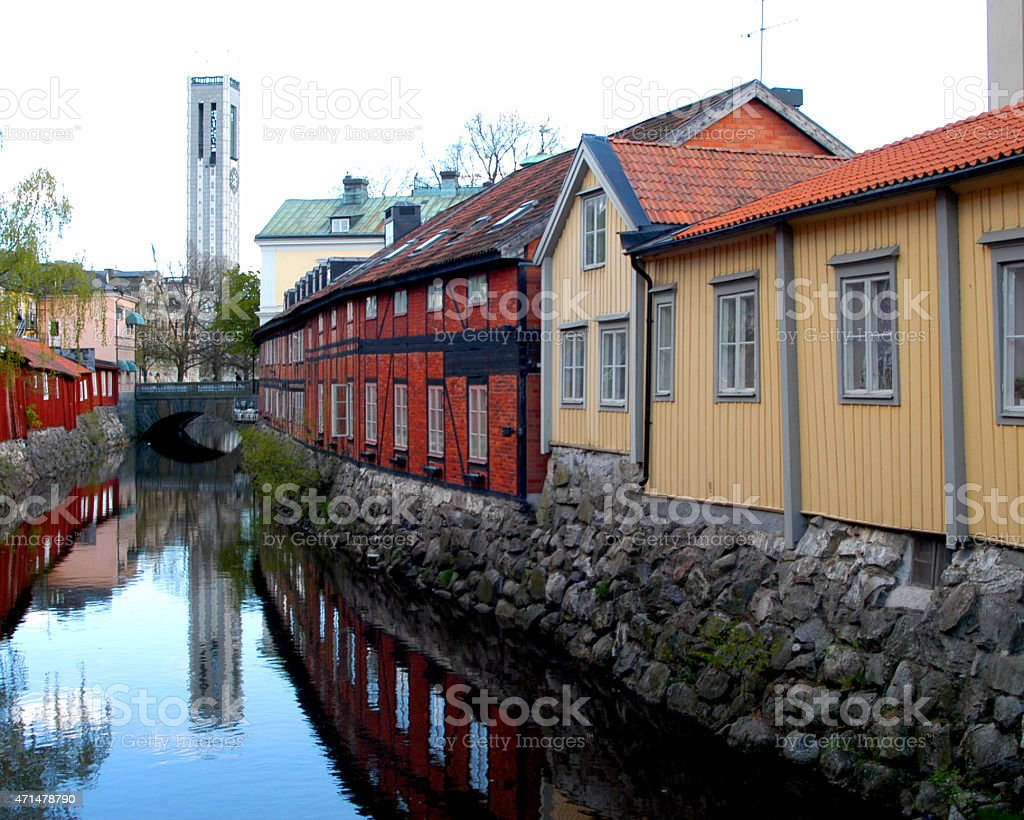 Rustic Buildings by River stock photo