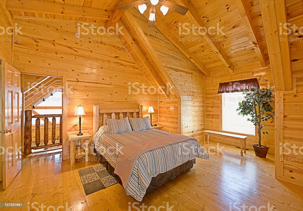 Rustic cabin bedroom loft royalty-free stock photo