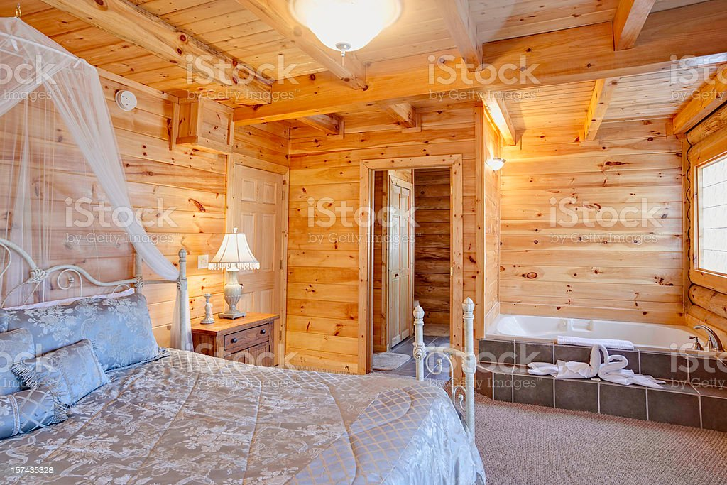 Rustic cabin bedroom with jacuzzi royalty-free stock photo