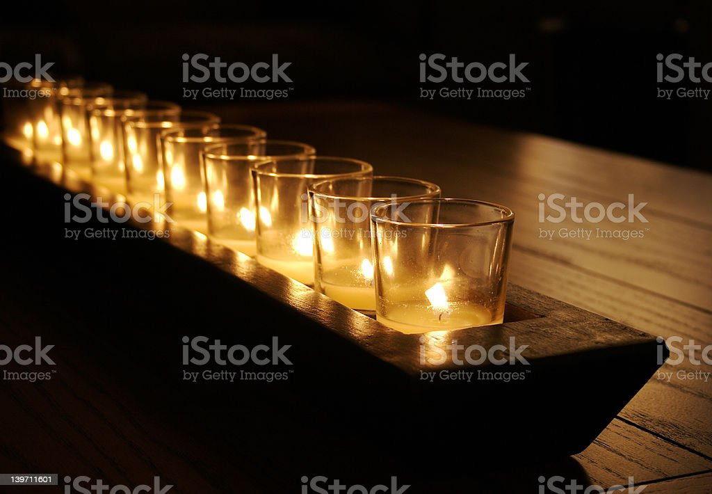 Rustic Candles on Wooden Table royalty-free stock photo