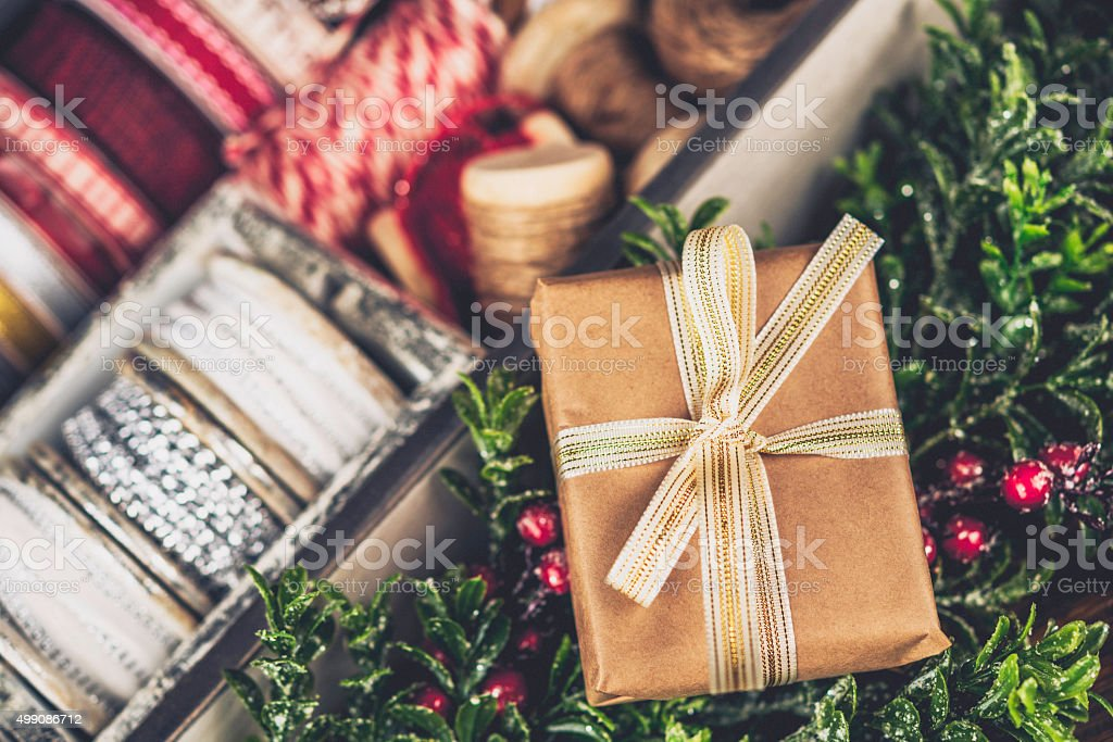 Rustic Christmas gift with assorted ribbons and twine stock photo