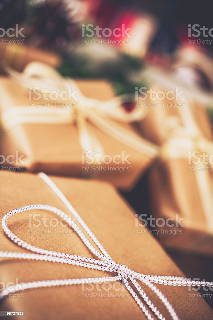 Rustic Christmas gifts with pinecones and ribbons stock photo