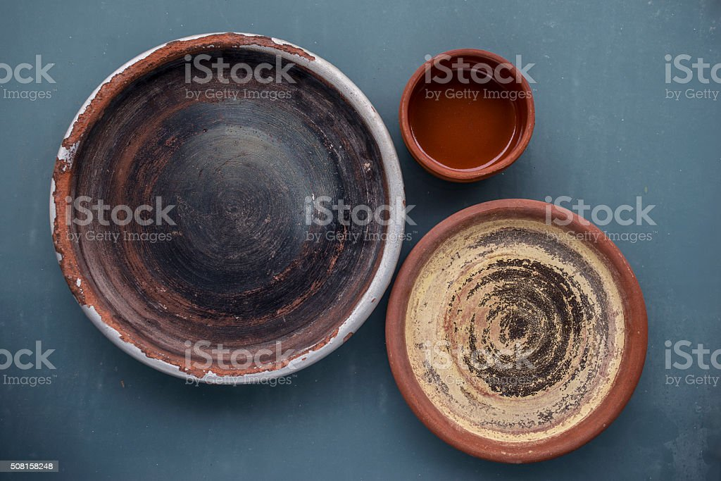 Rustic clay plates on the table stock photo