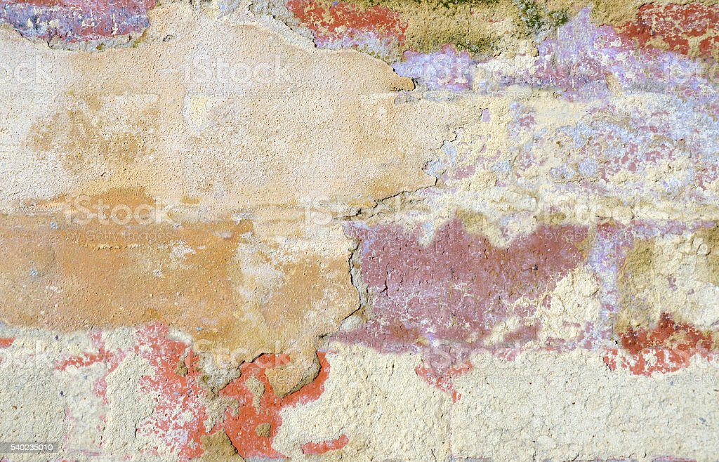 Rustic cracked and peeling rendered wall stock photo