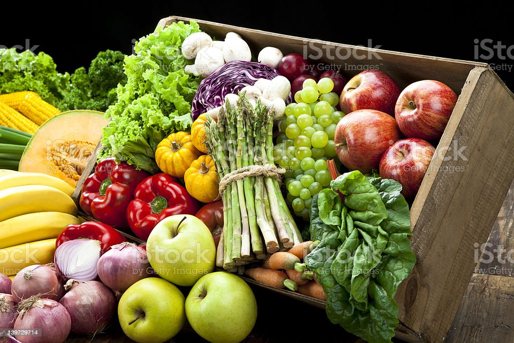 Rustic crate full of fruits and vegetables stock photo