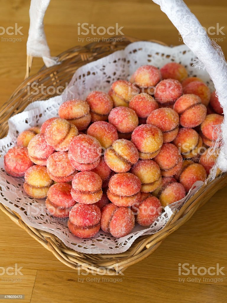 Rustic Croatian peach cakes in basket stock photo