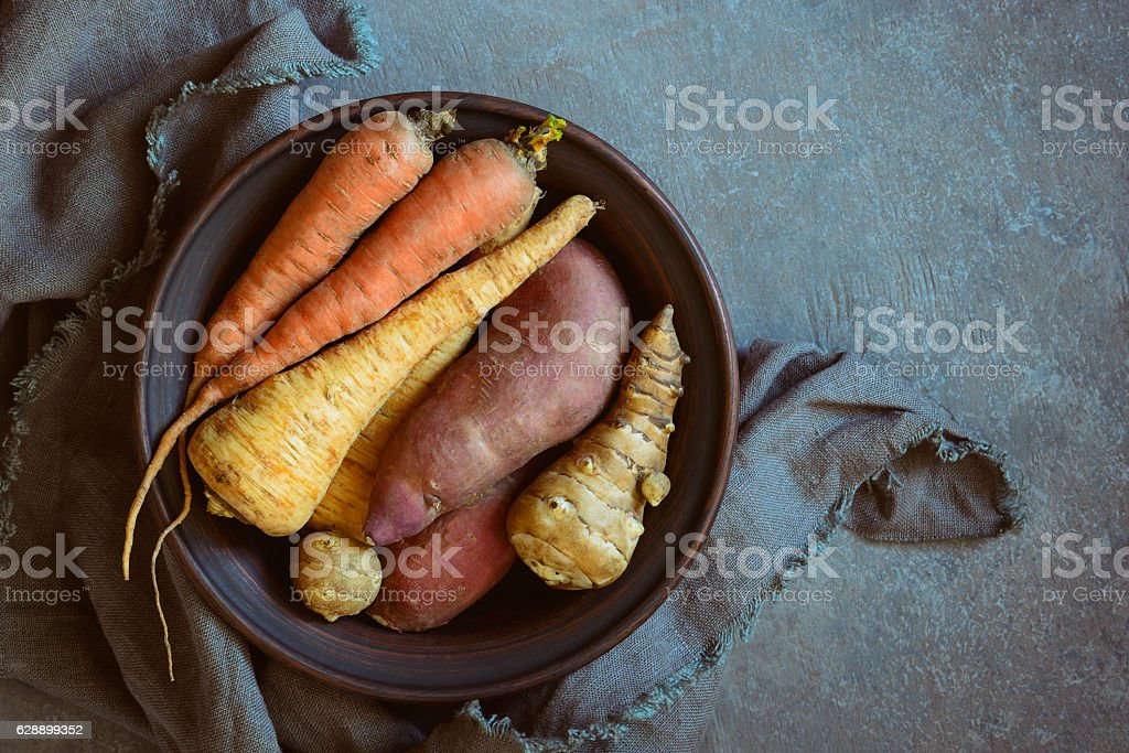 Rustic food ingredients, raw root vegetables such as organic...