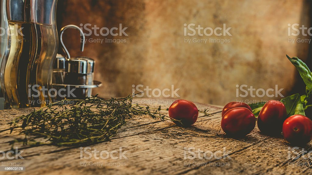 Rustic dinner table wit herbs and seasonings stock photo