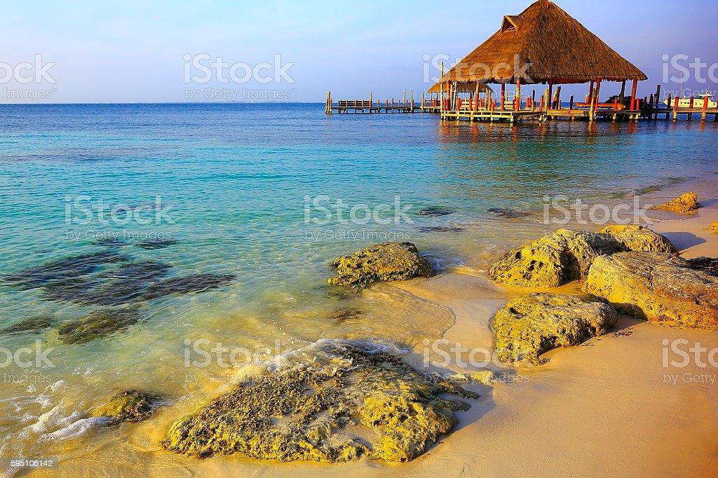 Rustic dock, Palapa - idyllic beach sunset – Cancun, Mexican caribbean stock photo